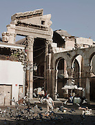 Ruins of a Roman arch at the entrance to the Al-Hamidiyah Souq, beside the Umayyad Mosque in Damascus, Syria