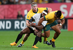 Fiji's Levani Botia is tackled by Australia's Izack Rodda and Allan Alaalatoa during the 2019 Rugby World Cup Pool D match at Sapporo Dome.