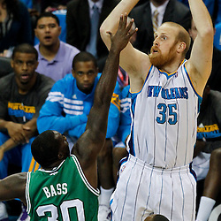 December 28, 2011; New Orleans, LA, USA; New Orleans Hornets center Chris Kaman (35) shoots over Boston Celtics power forward Brandon Bass (30) during the second quarter of a game at the New Orleans Arena. The Hornets defeated the Celtics 97-78.   Mandatory Credit: Derick E. Hingle-US PRESSWIRE