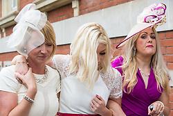 Ascot, UK. 20 June, 2019. Racegoers leave Royal Ascot after attending Ladies Day.