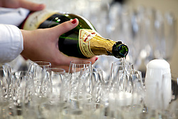 Champagne is poured as Blu Homes opens their West Coast factory on Mare Island in Vallejo, California Dec. 1, 2011.  Over 400 guests attended a ribbon cutting ceremony at the 250,000-square-foot facility.