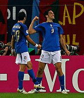Photo: Glyn Thomas.<br />Italy v Ukraine. Quarter Finals, FIFA World Cup 2006. 30/06/2006.<br /> Italy's Luca Toni (R) celebrates after scoring his side's third goal.