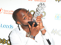 Davido with his award for best African act at the 22nd Mobo Awards held at Leeds First Direct Arena, Clay Pit Lane, Leeds.
