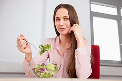 Young woman office eating lunch diet salad