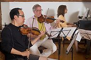 Jeffersonville, New York - World class musicians practice for a Weekend of Chamber Music concert at the Eddie Adams Barn on July 19, 2014. The event was part of the Weekend of Chamber Music's Summer Festival.