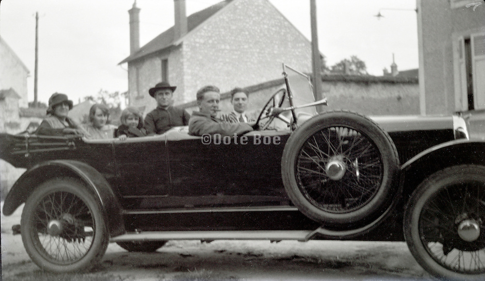young adult people with a priest in their car 1920s