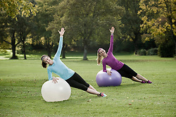 Women exercising in park with fitness ball, Woerthsee, Bavaria, Germany