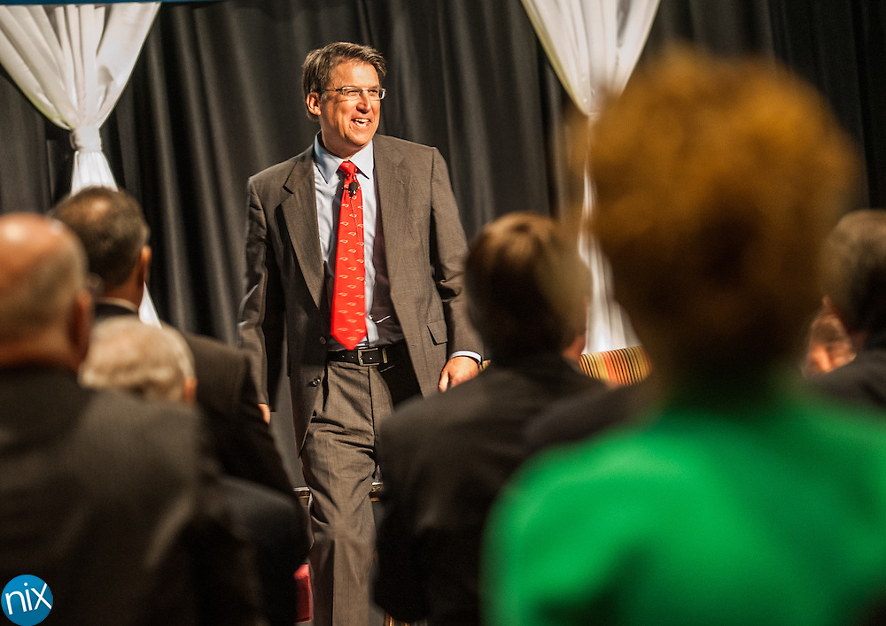Governor Pat McCrory is greeted by community leaders during a State of the Region Summit hosted by the Cabarrus Regional Chamber of Commerce Thursday morning at Embassy Suites in Concord.