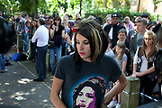 "Brandon Hayward (16) a loyal and deeply upset and distressed Amy Winehouse fan at the memorial opposite the home of Amy Winehouse, Camden Square, North London. In signature make up and wearing a t-shirt of her image, he said ""It's destroyed me. It's killed me. We hadn't seen too much of her in the press recently so thought things were alright, and now this, she's died. I don't know what to do, how I can make it better."" Brandon had first seen Winehouse at his first ever gig just aged 12 years old. It was announced that the tragic singer had died on 23rd July 2011. The music world has been paying tribute to singer Amy Winehouse, 27, who was found dead at her London home following years of drug and alcohol abuse largely attributed to her troubled character and fame."