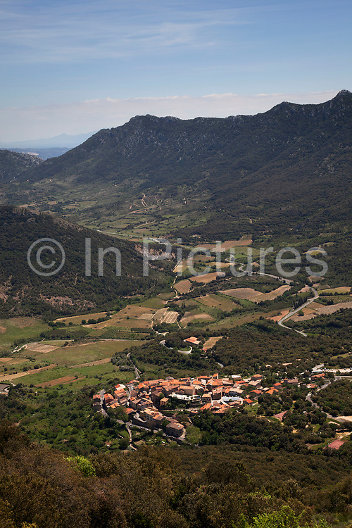 Looking down to the town of Duilhac-sous-Peyrepertuse. Peyrepertuse is a ruined fortress and one of the Cathar castles of the Languedoc located in the French Pyrénées in the commune of Duilhac-sous-Peyrepertuse, in the Aude département. It was associated with the Counts of Barcelona, later kings of Aragon. The name Peyrepetuse is derived from Pèirapertusa, Occitan, meaning Pierced Rock.