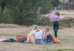 "© Licensed to London News Pictures. 12/09/2020. London, UK. Picnickers enjoy the glorious sunshine on Wimbledon Common in South West London this afternoon before the ""Rule of 6"" comes into force on Monday as weather experts announce a 6 day mini heatwave in the South East of England this week with highs in excess of 29c. Prime Minister Boris Johnson is already under pressure after he announced on Friday that gatherings of more than six people will be banned from Monday in the hope of reducing the coronavirus R number. The Rule of Six as it is known, has already become unpopular with MPs and large families. Photo credit: Alex Lentati/LNP"