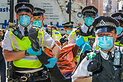 Police arrested a member of Extinction Rebellion Youth Cambridge who participated in a roadblock protest action outside Baringa Partners building in London on Thursday, Sept 10, 2020 - in an attempt to highlight the involvement of Schlumberger Limited in what they call 'ecocide'. Schlumberger is an oilfield services company working in more than 120 countries and has four principal executive offices located in Paris, Houston, London, and The Hague. An article at the Guardian suggests that it's ubiquitous in fossil fuel operations across the world, has more staff than Google, turns over more than Goldman Sachs, and is worth more than McDonald's – yet you won't have heard of it. XR Youth of Cambridge said that the British government gave 'Schlumberger' a no-strings-attached £150 million bailout loan as it was laying off a fifth of its global workforce. Another activist added: 'Schlumberger is hiding in plain sight here in Westminster. Every day, hundreds of people walk past this building with no idea that they're on the doorstep of a climate crime scene.'<br /> Environmental nonviolent activists group Extinction Rebellion enters its 10th and final day of continuous ten days protests to disrupt political institutions throughout peaceful actions swarming central London into a standoff, demanding that central government obeys and delivers Climate Emergency bill. (VXP Photo/ Vudi Xhymshiti)