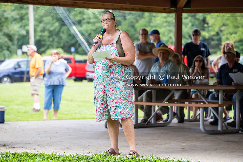 Maureen Ruhl speaks at a rally against a proposed natural gas power plant in Renovo, Pennsylvania on July 17, 2021. The Pennsylvania Department of Environmental Protection granted a permit in April 2021 for Renovo Energy Center LLC to construct and operate a gas-fired power plant in Renovo Borough. (Photo by Paul Weaver)