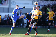Pawel Cibicki of Leeds Utd is challenged by Scot Bennett  of Newport county. Emirates FA Cup , 3rd round match, Newport county v Leeds Utd at Rodney Parade in Newport, South Wales on Sunday 7th January 2018.<br /> pic by Andrew Orchard,  Andrew Orchard sports photography.