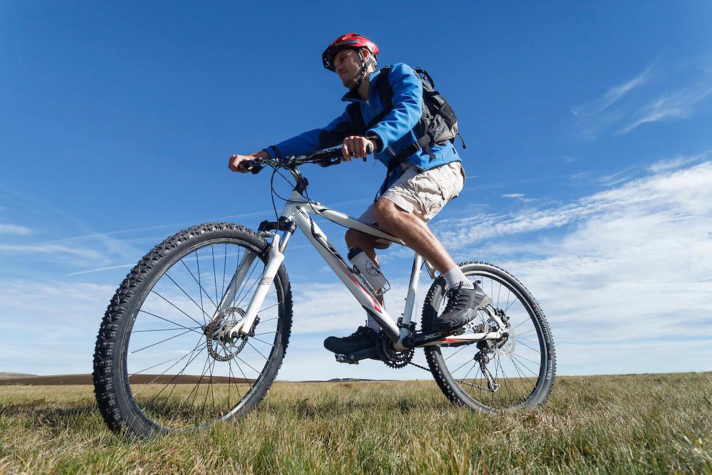 Mountain biker at Col des Supeyres