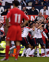 Fotball<br /> Foto: BPI/Digitalsport<br /> NORWAY ONLY<br /> <br /> England v Wales<br /> 09.10.2004<br /> <br /> Ryan Giggs stands glumly in the foreground as David Beckham celebrates making it 2-0