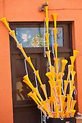 Plastic vuvuzela horns on sale in Old San Juan, Puerto Rico.