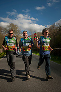 """Local council representatives carry the baton while running on the 20th Korrika. Erratzu (Basque Country) April 3, 2017. The """"Korrika"""" is a relay course, with a wooden baton that passes from hand to hand without interruption, organised every two years in a bid to promote the basque language. The Korrika runs over 11 days and 10 nights, crossing many Basque villages and cities, totalling some 2300 kilometres. Some people consider it an honour to carry the baton with the symbol of the Basques, """"buying"""" kilometres to support Basque language teaching. (Gari Garaialde / Bostok Photo)"""