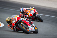 MARQUEZ Marc of Spain and Repsol Honda Team in action with PEDROSA Dani of Spain and Repsol Honda Team with a flag during the Moto GP Valencia Grand Prix at Ricardo Tormo circuit, Cheste in Spain on november 09, 2014 - Photo Milagro / DPPI
