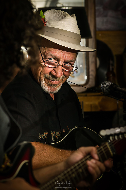 Earl Arnold on stage perfoming with the Back Alley Boys during a show at The Bus Stop Music Cafe in Pitman, NJ.