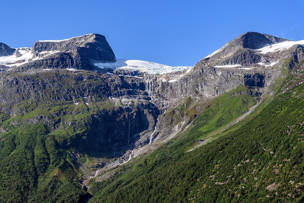 Waterfall from Senlenske Glacier (Loen. Stryn, Vesland), western Norway.  The edge of the glacier is visible. The two peaks are 1500-1700 m in elevation.