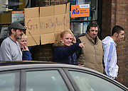 """© Licensed to London News Pictures. 13/11/2012. London, UK Protesters point and hold a sign saying """"get rid of Abu Qatada"""" as Terror suspect Abu Qatada arrives home after he was released from jail following his dramatic victory against deportation. Photo credit : Stephen Simpson/LNP"""