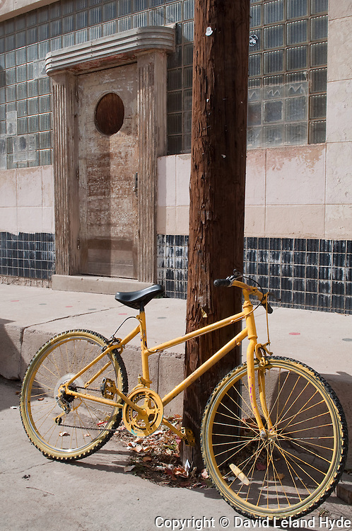 Yellow Bicycle, street, Telephone Pole, Urban Decay, wooden door, wall tile, Silver City, New Mexico, 2009 by David Leland Hyde.