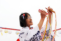 """Adults lead the children in """"bon odori"""" dances at Sunday's 63rd annual Obon Festival at the Buddhist Temple of Salinas."""
