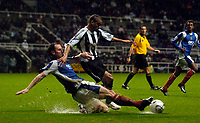 Photo: Jed Wee.<br /> Newcastle United v Portsmouth. Carling Cup. 25/10/2006.<br /> <br /> Newcastle's Kieron Dyer (R) is tackled by Portsmouth's Andy O'Brien.