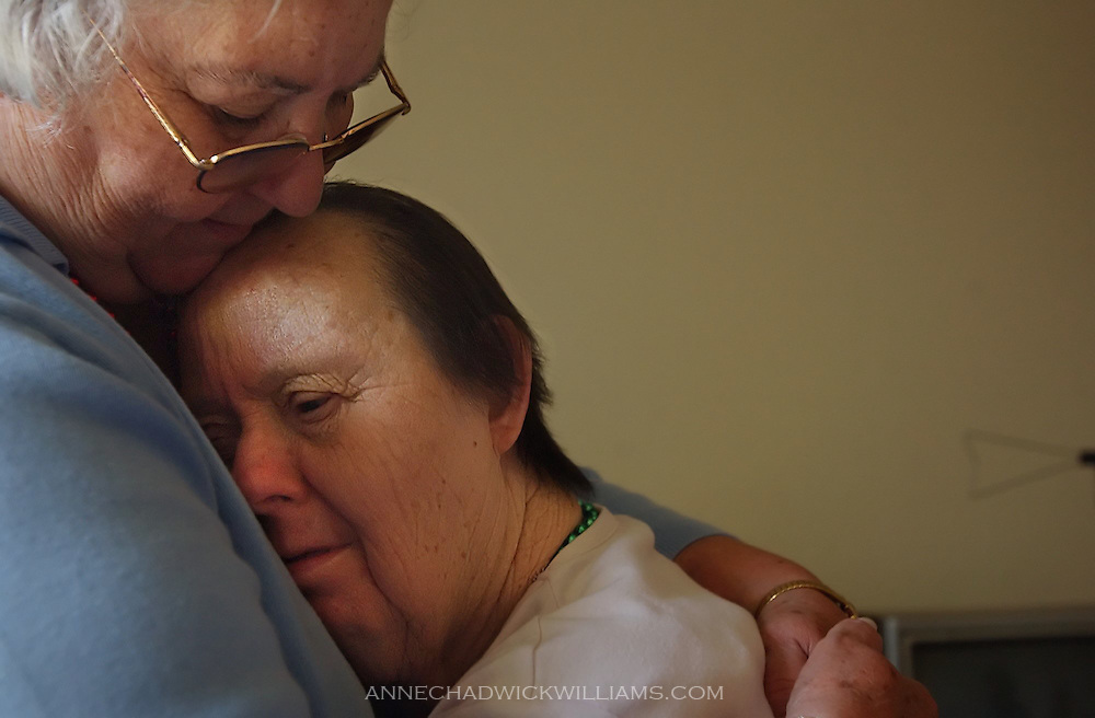 Irene Pinole is one of the oldest people with Down Syndrome. Irene, 76, sinks into the arms of her sister, Olga Johnson, who she hasn't seen in 65 years. Irene, who has Down syndrome, was taken from her Calistoga home as a child and put in a state mental hospital. After reading an article in the Bee last week, Johnson discover that her sister was still alive. Anne Chadwick Williams / June 5, 2004 /Sacramento Bee/