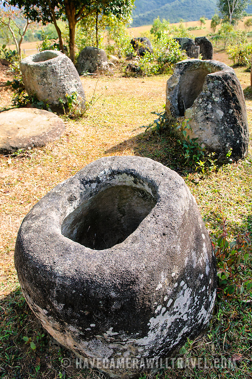 Some of the round stone jars at Site 3 of the Plain of Jars in north-central Laos. Much remains unknown about the age and purpose of the thousands of stone jars clustered in the region. Most accounts date them to at least a couple of thousand years ago and theories have been put forward that they were used in burial rituals.
