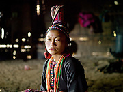 Portrait of Eupae, a married Ko Pala ethnic minority woman at home, Ban Honglerk, Phongsaly Province, Lao PDR. The conservative clothing of the older Pala women is in contrast to the brightly coloured, flamboyant constumes of the young Pala women. One of the most ethnically diverse countries in Southeast Asia, Laos has 49 officially recognised ethnic groups although there are many more self-identified and sub groups. These groups are distinguished by their own customs, beliefs and rituals. Details down to the embroidery on a shirt, the colour of the trim and the type of skirt all help signify the wearer's ethnic and clan affiliations.