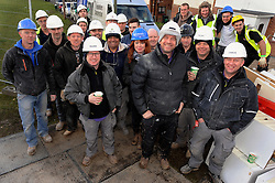 © Licensed to London News Pictures. 12/03/2013.The BBC's DIYSOS team are in Orpington, Kent this week till the (21.03.2013). Nick Knowles and the team of builders  which includes local tradesmen arrived on the (12.03.2013) to help build a family in need a new home.. DIYSOS team with local tradesmen..Photo credit : Grant Falvey/LNP