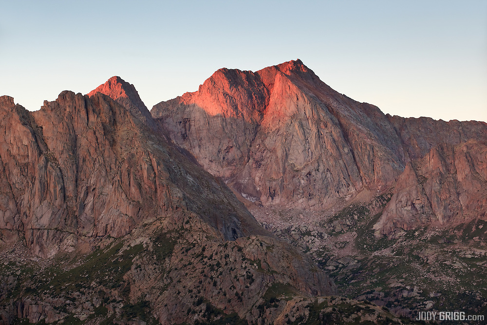 Sunrise on North Eolus's  north face is viewed from a high slope in Noname Creek.