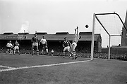 24/05/1964<br /> 05/24/1964<br /> 24 May 1964<br /> Soccer International: Ireland v England at Dalymount Park, Dublin. England won the game 3-1.  Noel Dwyer, Irish keeper, reaches for this header from Jimmy Greaves (second from right) but it went over the bar. Others in the picture are Noel Cantwell (left), Irish Captain and Mick McGrath (Irish half back).
