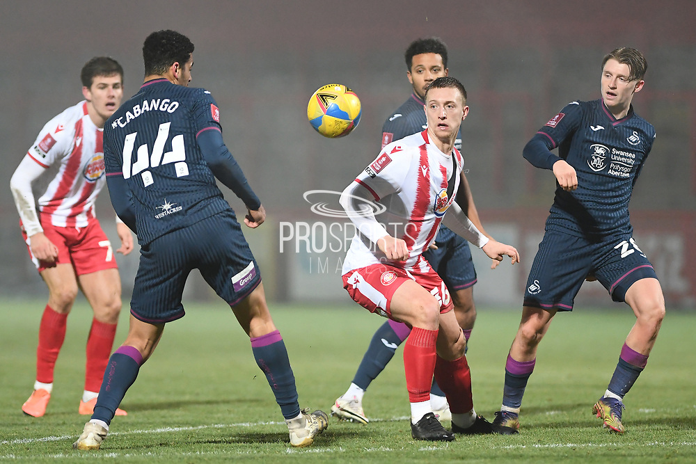 Swansea City defender Ben Cabango(44) Stevenage forward Luke Norris(36) and Swansea City midfielder George Byers(28) during the FA Cup match between Stevenage and Swansea City at the Lamex Stadium, Stevenage, England on 9 January 2021.