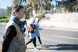 18 March 2019, Bethlehem, Occupied Palestinian Territories: Ecumenical Accompaniers from the World Council of Churches' Ecumenical Accompaniment Programme in Palestine and Israel spend the morning doing a 'school run', by which they offer a peaceful protective presence for Palestinian children as they go to school at Al Minya.  With Israeli settler communities nearby, strong military presence, and a high-speed road passing just by the school entrance, an international presence can help ensure safe passage for the children. Here, EA Jane from Scotland.