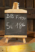 BiB Fitou 5 litres 18 euro. Advertising bag in box wine. Domaine Bertrand-Berge In Paziols. Fitou. Languedoc. The wine shop and tasting room. France. Europe.