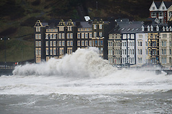 """© London News Pictures. 08/02/2014. Aberystwyth, UK. <br /> Gale force winds and giant waves strike the sea walls at Aberystwyth, Wales at high tide. The winds are forecast to strengthen throughout the day, gusting up to 70 or 80 mph, and with the rising tide, their impact could be potentially damaging again. An amber """"be prepared"""" warning  has been issued by the Met Office for wind,. Photo credit: Keith Morris/LNP"""