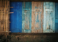 painted wood walls, Savannakhet, Laos, Asia. Blue tones and nice patina of the shutters.