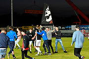 Exeter City fans invade the pitch to celebrate after Exeter City beat Lincoln City 3-1 to book a place in the play off final at Wembley during the EFL Sky Bet League 2 match between Exeter City and Lincoln City at St James' Park, Exeter, England on 17 May 2018. Picture by