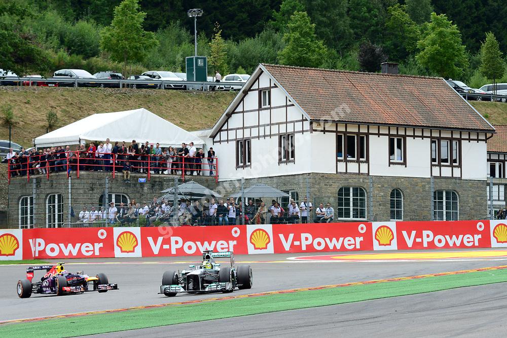 Nico Rosberg (Mercedes) leads Mark Webber (Red Bull-Renault) in the 2013 Belgian Grand Prix in Spa-Francorchamps. Photo: Grand Prix Photo