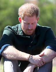 The Duke of Sussex participates in a group activity to promote positive thinking during a visit to Waves for Change at Monwabisi Beach in Cape Town, on day two of their tour of Africa.