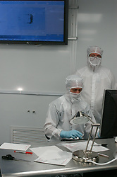 Stock photo of a two scientists analyzing results at NASA's Stardust Lab in Houston Texas