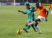 Photo: Steve Bond/Richard Lane Photography.<br />Nigeria v Ivory Coast. Africa Cup of Nations. 21/01/2008. Salomon Kalou (R) gets a shot in as defender Apam Onyekachi (L) closes in