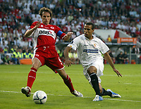Photo: Chris Ratcliffe.<br /> Middlesbrough v Sevilla. UEFA Cup Final. 10/05/2006.<br /> Middlesbrough's Gareth Southgate tries to stop Sevilla's Luis Fabiano.