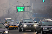 Imported BMW X5 4 wheel drive vehicle in traffic on Beijing main street, China