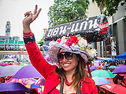 19 MAY 2013 - BANGKOK, THAILAND:   A Red Shirt cheers during a Red Shirt rally in Ratchaprasong Intersection honoring Red Shirts killed by the Thai army in 2010. More than 85 people, most of them civilians, were killed during the Thai army crackdown against the Red Shirt protesters in April and May 2010. The Red Shirts were protesting against the government of Abhisit Vejjajiva, a member of the opposition who became Prime Minister after Thai courts ruled the Red Shirt supported government was unconstitutional. The protests rocked Bangkok from March 2010 until May 19, 2010 when Thai troops swept through the protest areas arresting hundreds.    PHOTO BY JACK KURTZ