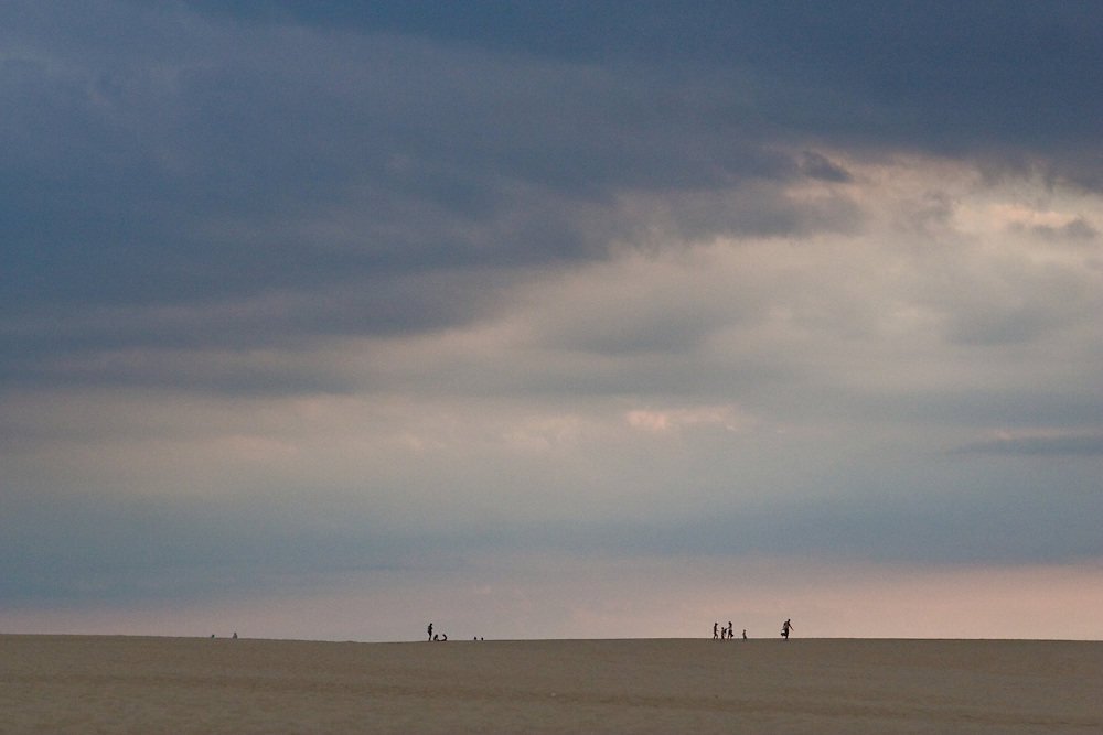 People enjoying the last few moments before dusk at Jockey's Ridge, North Carolina.