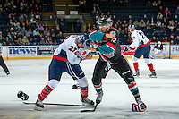 KELOWNA, CANADA, OCTOBER 16 - Tyrell Goulbourne #12 of the Kelowna Rockets drops the gloves with Kade Jesen #23 of the Lethbridge Hurricanes on Wednesday, October 16, 2013 at Prospera Place in Kelowna, British Columbia (photo by Marissa Baecker/Getty Images)***Local Caption***